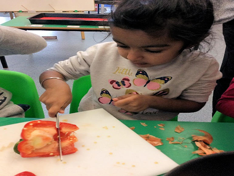Cutting up vegetables in Nursery
