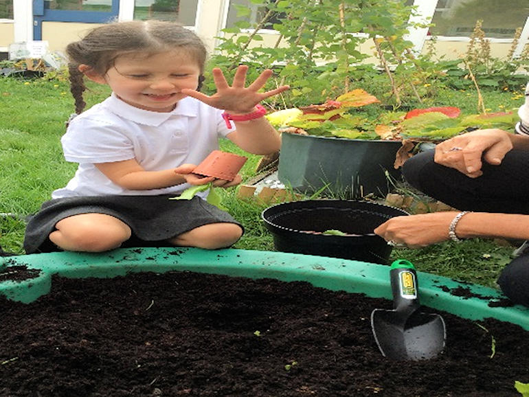 Learning how to plant in Nursery