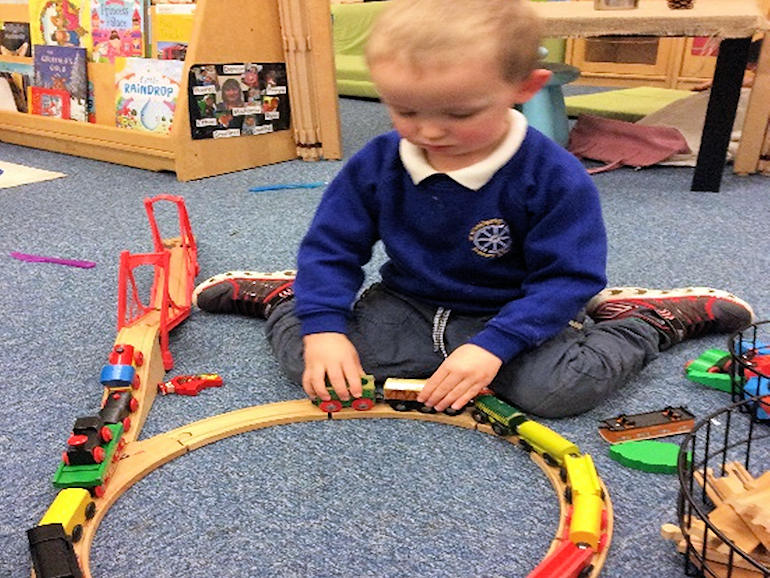 Playing trains in Nursery