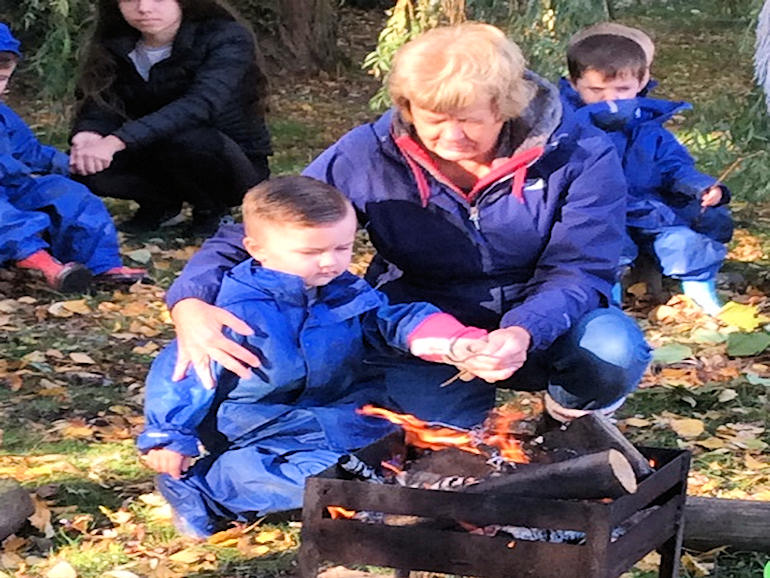 Carefully building a fire at Forest School