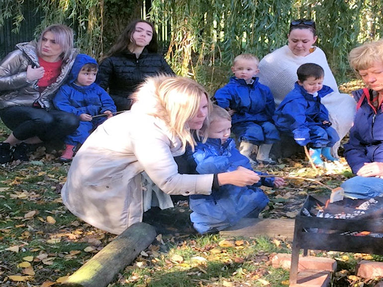 Toasting marshmallows at Forest School