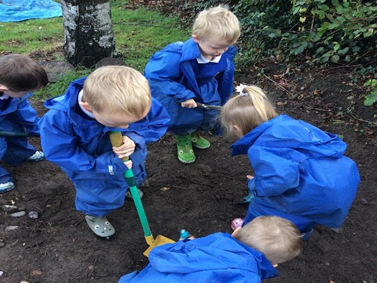 Children digging in the soil